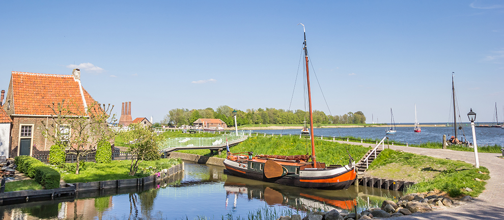 Panorama of a sailing ship at a dike in Enkhuizen